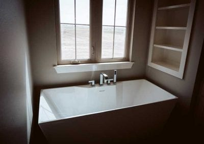 inset shelving installed near bath tub
